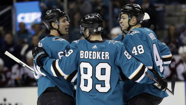 San-Jose-Sharks'-Justin-Braun,-left,-celebrates-his-goal-with-teammates-Mikkel-Boedker-(89)-and-Tomas-Hertl-(48)-during-the-first-period-of-an-NHL-hockey-game-against-the-Colorado-Avalanche-on-Thursday,-April-5,-2018,-in-San-Jose,-Calif.-(Marcio-Jose-Sanchez/AP)