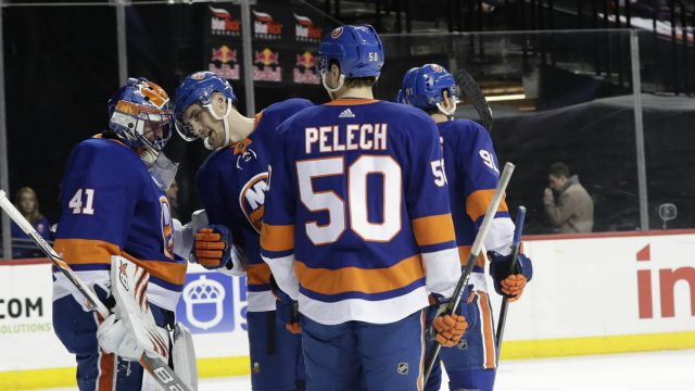 New-York-Islanders-goaltender-Jaroslav-Halak-(41)-celebrates-with-teammates-as-New-York-Rangers'-Mika-Zibanejad-(93)-skates-away-after-an-NHL-hockey-game-Thursday,-April-5,-2018,-in-New-York.-The-Islanders-won-2-1.-(Frank-Franklin-II/AP)