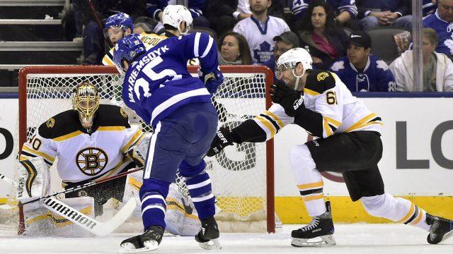 Toronto-Maple-Leafs-left-wing-James-van-Riemsdyk-(25)-shoots-on-Boston-Bruins-goaltender-Tuukka-Rask-(40)-as-Boston-Bruins-left-wing-Rick-Nash-(61)-defends-during-first-period-NHL-round-one-playoff-hockey-action-in-Toronto-on-Monday,-April-23,-2018.-(Frank-Gunn/CP)