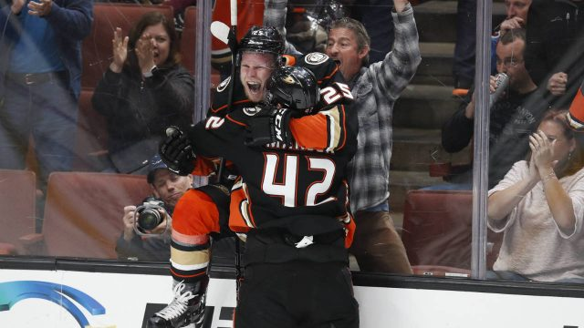 Anaheim-Ducks'-Ondrej-Kase,-top,-of-the-Czech-Republic,-celebrates-his-overtime-goal-with-Josh-Manson-in-an-NHL-hockey-game-against-the-Colorado-Avalanche-on-Sunday,-April-1,-2018,-in-Anaheim,-Calif.-The-Ducks-won-4-3.-(Jae-C.-Hong/AP)