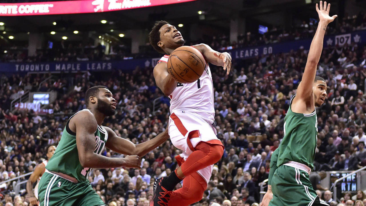 Toronto-Raptors-guard-Kyle-Lowry-(7)-is-fouled-by-Boston-Celtics-forward-Jayson-Tatum-(right)-as-he-goes-to-the-basket-by-guard-Kadeem-Allen-(left)-during-second-half-NBA-basketball-action-in-Toronto-on-Wednesday,-April-4,-2018.-(Frank-Gunn/CP)