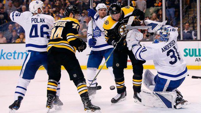 Boston-Bruins'-David-Backes-(42)-battles-for-a-rebound-off-Toronto-Maple-Leafs'-Frederik-Andersen-(31)-during-the-second-period-of-Game-5-of-an-NHL-hockey-first-round-playoff-series-in-Boston.