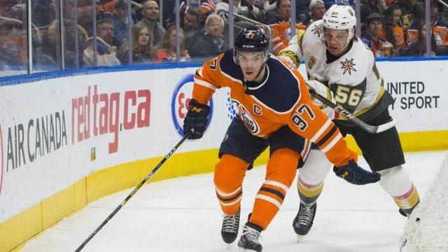 Vegas-Golden-Knights'-Erik-Haula-(56)-pressures-Edmonton-Oilers'-Connor-McDavid-(97)-during-second-period-NHL-hockey-game-action-in-Edmonton,-Alberta,-Thursday,-April-5,-2018.-(Amber-Bracken/The-Canadian-Press-via-AP)