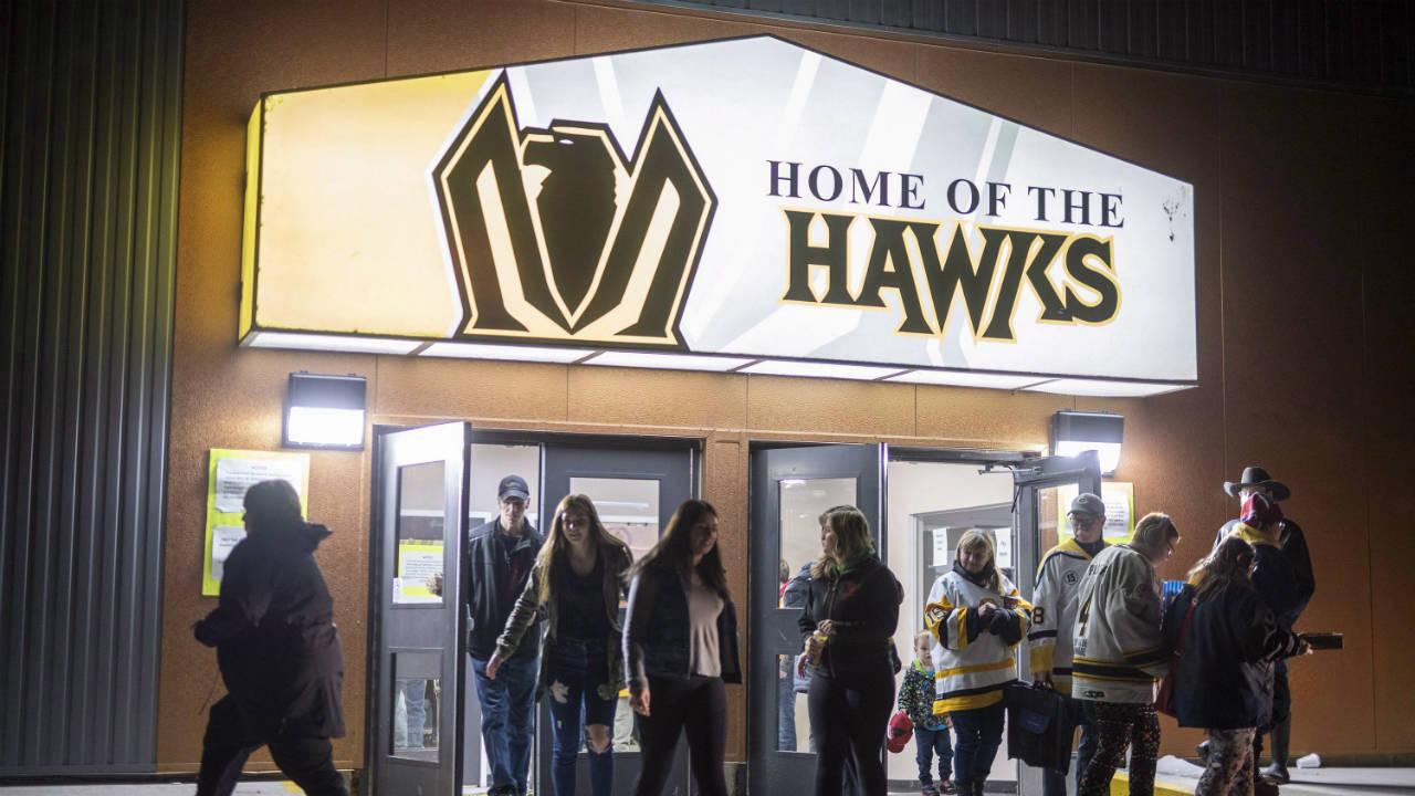 People-leave-game-one-of-the-Saskatchewan-Junior-Hockey-league-finals-between-the-Estevan-Bruins-and-Nipawin-Hawks-in-Nipawin,-Sask.-on-Saturday,-April-14,-2018.-(Liam-Richards/CP)
