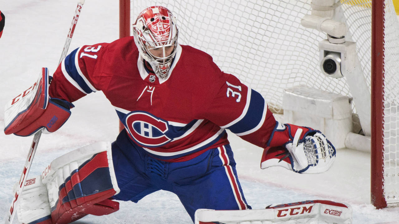 Montreal-Canadiens-goaltender-Carey-Price-makes-a-save-against-the-New-Jersey-Devils-during-first-period-NHL-hockey-action-in-Montreal,-Sunday,-April-1,-2018.-(Graham-Hughes/CP)