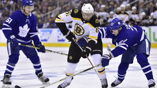 Boston-Bruins-left-wing-Rick-Nash-(61)-and-Toronto-Maple-Leafs-defenceman-Nikita-Zaitsev-(22)-battle-for-the-puck-during-first-period-NHL-round-one-playoff-hockey-action-in-Toronto-on-Monday,-April-23,-2018.-(Frank-Gunn/CP)