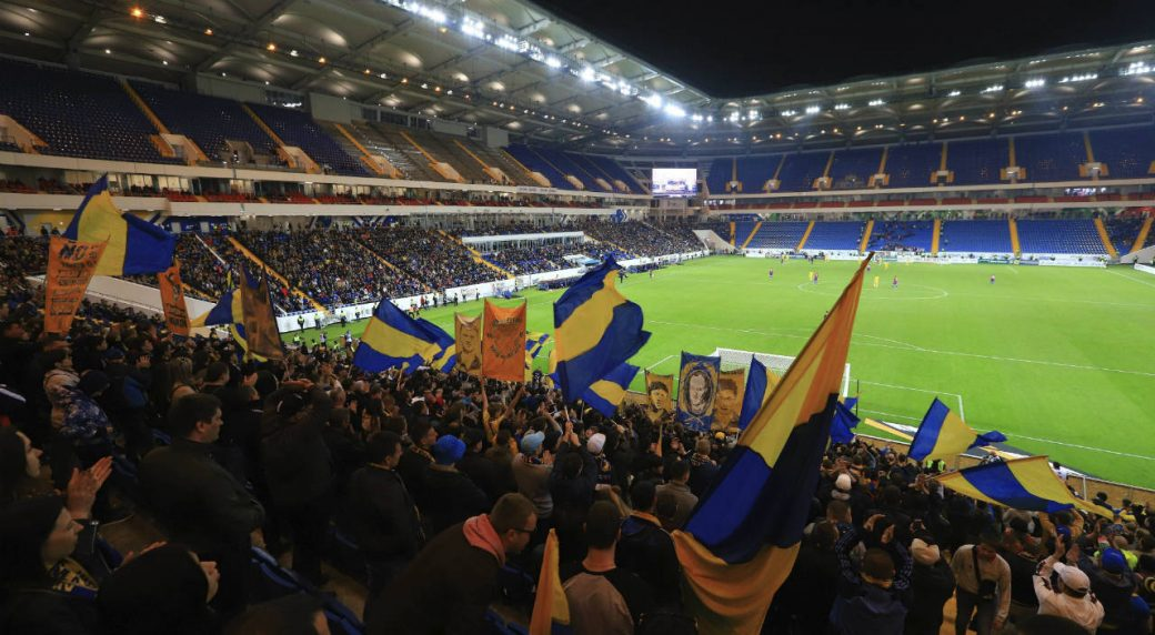 Rostov-soccer-team-fans-react-during-the-Russian-Premier-League-soccer-match-between-Rostov-and-SCA-Khabarovsk-at-the-new-Rostov-Arena-in-Rostov-on-Don,-Russia,-Sunday,-April-15,-2018.-Rostov-Arena-will-host-matches-in-the-2018-FIFA-World-Cup.-(AP-Photo)