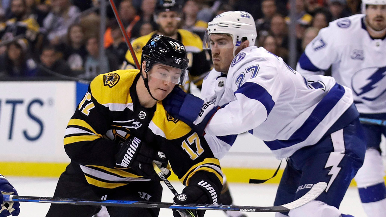 Boston-Bruins-centre-Ryan-Donato-skates-into-the-Tampa-Bay-Lightning-defence-during-an-NHL-hockey-game-in-March-2018