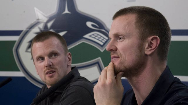 Vancouver-Canucks-Henrik,-right,-and-Daniel-Sedin-announce-their-retirements-from-hockey-during-a-news-conference-at-Rogers-Arena-in-Vancouver,-Monday,-April,-2,-2018.-(Jonathan-Hayward/CP)