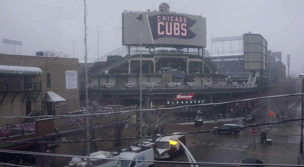 Snow-falls-at-Wrigley-Field-on-the-morning-of-Chicago's-home-opener-baseball-game-against-the-Pittsburgh-Pirates,-Monday,-April-9,-2018,-in-Chicago.-(Kiichiro-Sato/AP)