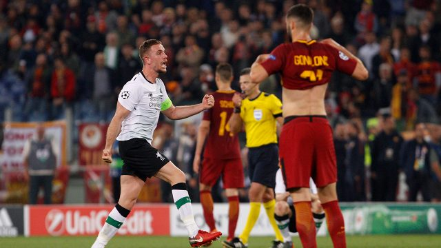 Liverpool's-Jordan-Henderson,-left,-celebrates-at-the-end-of-the-Champions-League-semifinal-second-leg-soccer-match-between-Roma-and-Liverpool.