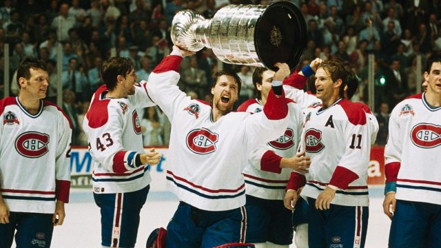 Montreal-Canadiens-goaltender-Patrick-Roy-raises-the-Stanley-Cup-in-1993.