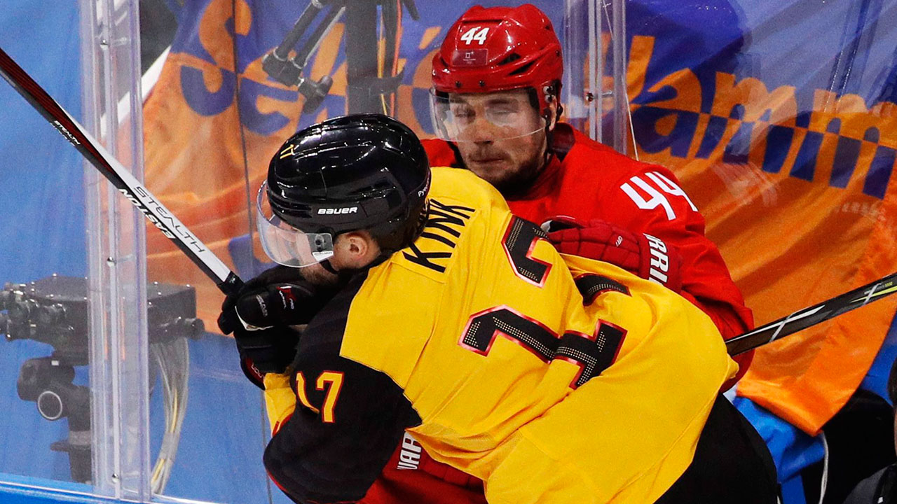 Marcus-Kink-(17),-of-Germany,-collides-with-Russia's-Egor-Yakovlev-(44)-during-the-third-period-of-the-men's-gold-medal-hockey-game-at-the-2018-Winter-Olympics,-in-Gangneung,-South-Korea.