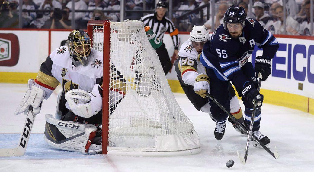Winnipeg-Jets'-Mark-Scheifele-(55)-drives-behind-Vegas-Golden-Knights'-goaltender-Marc-Andre-Fleury-(29)-with-Nate-Schmidt-(88)-trailing-behind-during-Game-2-of-the-NHL's-Western-Conference-Final-in-Winnipeg.