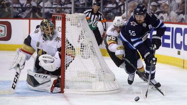 Winnipeg-Jets'-Mark-Scheifele-(55)-drives-behind-Vegas-Golden-Knights'-goaltender-Marc-Andre-Fleury-(29)-with-Nate-Schmidt-(88)-trailing-behind-during-Game-2-of-the-NHL's-Western-Conference-Final-in-Winnipeg.