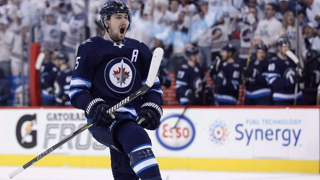 Winnipeg-Jets'-Mark-Scheifele-celebrates-a-goal.