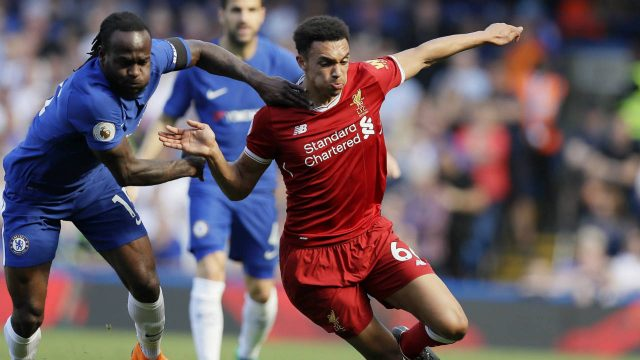 Chelsea's-Victor-Moses,-left,-challenges-for-the-ball-with-Liverpool's-Trent-Alexander-Arnold-during-the-English-Premier-League-soccer-match-between-Chelsea-and-Liverpool-at-Stamford-Bridge-stadium-in-London,-Sunday,-May-6,-2018.-(Kirsty-Wigglesworth/AP)