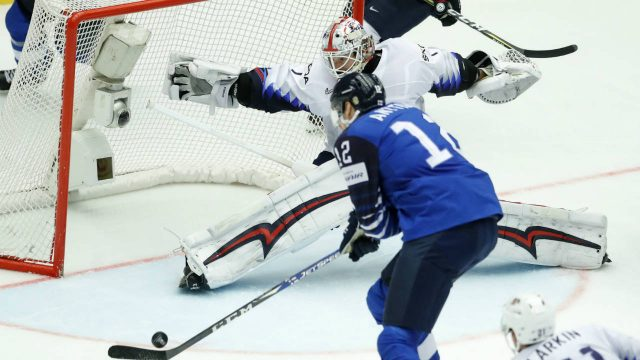 Finland's-Marko-Anttila,-left,-scores-past-Keith-Kinkaid,-centre,-of-the-United-States-and-Dylan-Larkin,-right,-during-the-Ice-Hockey-World-Championships-group-B-match-between-Finland-and-the-United-States-at-the-Jyske-Bank-Boxen-arena-in-Herning,-Denmark,-Tuesday,-May-15,-2018.-(Petr-David-Josek/AP)