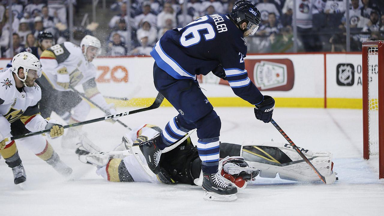 Winnipeg-Jets'-Blake-Wheeler-beats-Vegas-Golden-Knights-goaltender-Marc-Andre-Fleury-(29)-but-misses-the-open-net-during-Game-1-of-the-2018-Western-Conference-Final