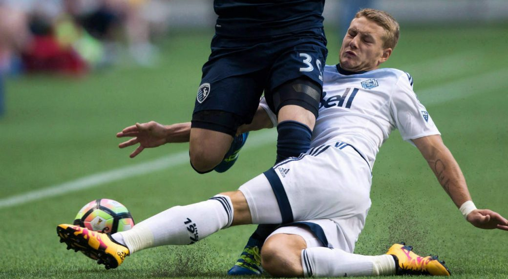 Vancouver-Whitecaps'-Brett-Levis,-right.-(Darryl-Dyck/CP)