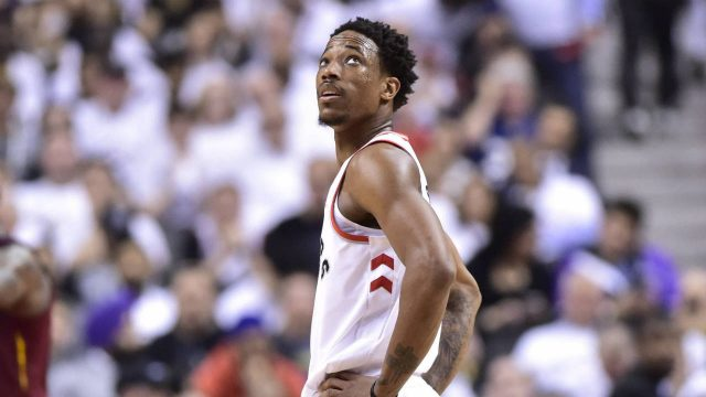 Toronto-Raptors-guard-DeMar-DeRozan-(10)-looks-up-at-the-scoreboard-late-in-the-second-half-NBA-playoff-basketball-action-against-the-Cleveland-Cavaliers-in-Toronto-on-Thursday,-May-3,-2018.-(Frank-Gunn/CP)