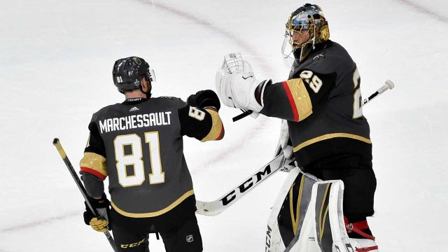 Vegas-Golden-Knights-centre-Jonathan-Marchessault,-left,-celebrates-with-goaltender-Marc-Andre-Fleury