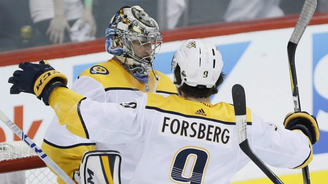 Nashville-Predators-goaltender-Pekka-Rinne-(35)-and-Filip-Forsberg-(9)-celebrate-a-win-over-the-Winnipeg-Jets-in-NHL-round-two-game-four-playoff-action-in-Winnipeg-on-Thursday,-May-3,-2018.-(John-Woods/CP)