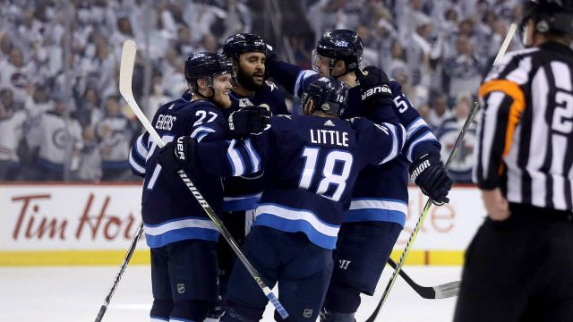 The-Winnipeg-Jets-celebrate-after-Dustin-Byfuglien-(33)-scored-against-the-Nashville-Predators-during-second-period-NHL-hockey-playoff-action-in-Winnipeg,-Tuesday,-May-1,-2018.-(Trevor-Hagan/CP)