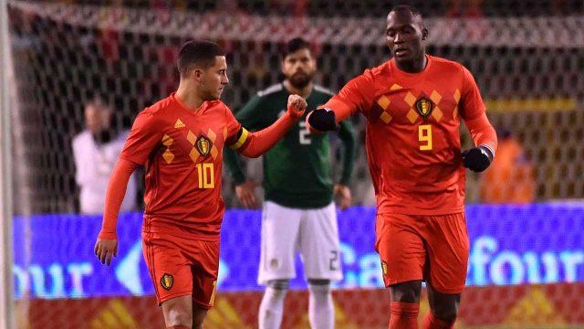 Belgium's-Romelu-Lukaku,-right,-celebrates-with-his-teammate-Eden-Hazard