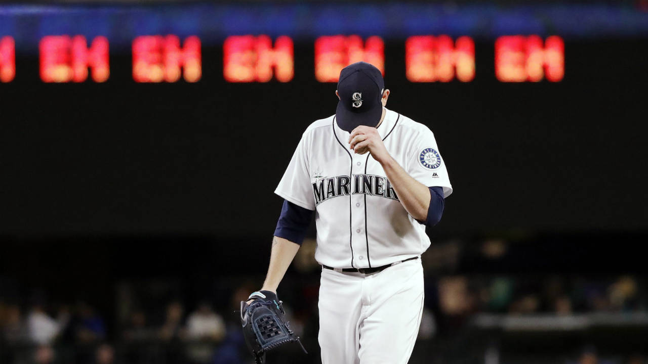 "Seattle-Mariners-starting-pitcher-James-Paxton-gets-ready-for-the-next-batter-after-striking-out-an-Oakland-Athletics-player-as-a-line-of-""eh's,""-a-nod-to-Paxton's-Canadian-heritage-and-his-strikeout-count,-appears-on-a-scoreboard-during-the-seventh-inning-of-a-baseball-game-Wednesday,-May-2,-2018,-in-Seattle.-(Elaine-Thompson/AP)"