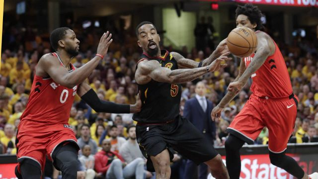Cleveland-Cavaliers'-JR-Smith-(5)-passes-against-Toronto-Raptors'-CJ-Miles-(0)-and-Lucas-Nogueira-in-the-first-half-of-Game-4-of-an-NBA-basketball-second-round-playoff-series,-Monday,-May-7,-2018,-in-Cleveland.