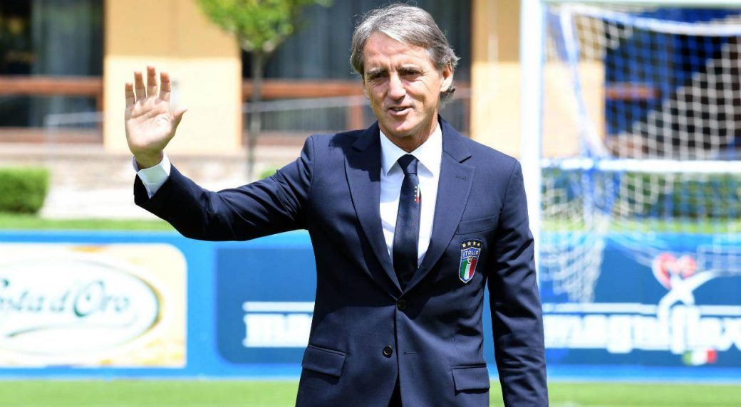 Italy's-soccer-national-team-new-coach-Roberto-Mancini-smiles-leaves-after-his-first-press-conference-at-Coverciano-Sporting-Center,-in-Florence,-Italy,-Tuesday-May-15,-2018.-Italy-coach-Roberto-Mancini-says-he-will-talk-to-long-excluded-striker-Mario-Balotelli-about-a-possible-return-to-the-national-team.-(Claudio-Giovannini/ANSA-via-AP)