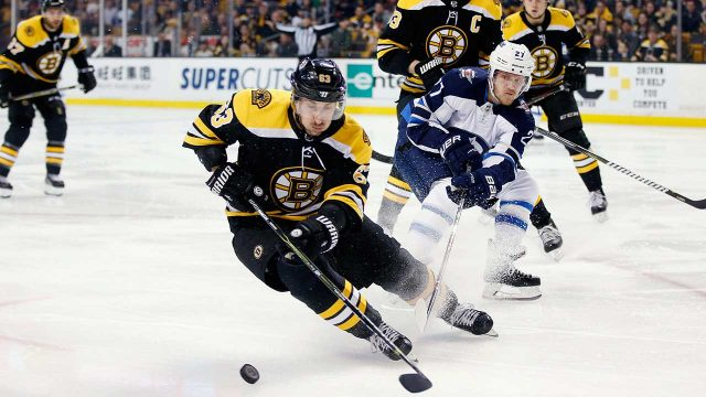Boston-Bruins'-Brad-Marchand-(63)-and-Winnipeg-Jets'-Nikolaj-Ehlers-(27)