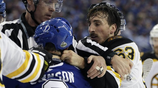Boston-Bruins-left-wing-Brad-Marchand-(63)-and-Tampa-Bay-Lightning-center-Tyler-Johnson-(9)-scrap-during-the-first-period-of-Game-2-of-an-NHL-second-round-hockey-playoff-series-Monday,-April-30,-2018,-in-Tampa,-Fla.-Johnson-was-penalized-for-roughing.-(Chris-O'Meara/AP)
