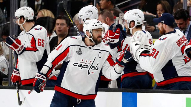 alex-ovechkin-celebrates-with-teammates-after-scornig