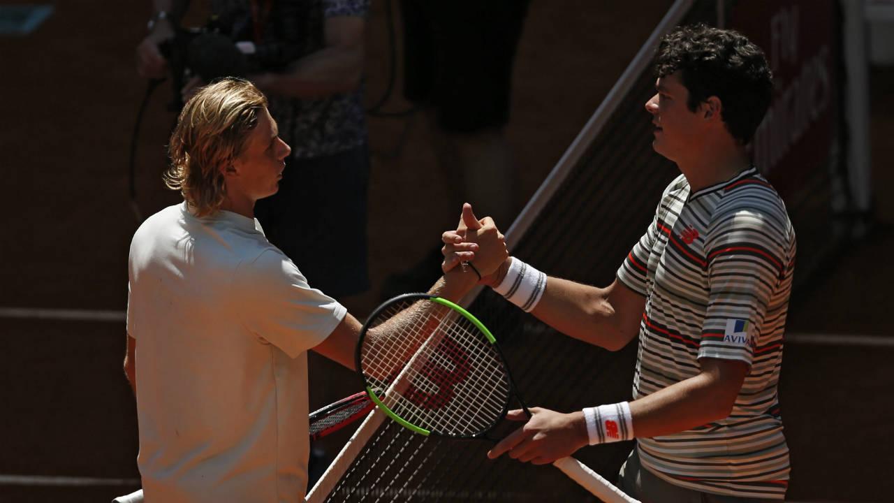 Denis-Shapovalov-from-Canada,-left,-shakes-hands-with-countryman-Milos-Raonic.-(Francisco-Seco/AP)