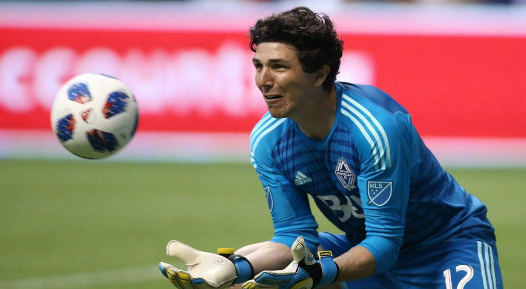 Vancouver-Whitecaps-goalkeeper-Brian-Rowe-makes-a-save-against-the-Houston-Dynamo-during-first-half-MLS-soccer-action-in-Vancouver-on-Friday-May-11,-2018.-Goalkeeper-Rowe-is-looking-to-get-his-second-start-when-the-Whitecaps-face-the-San-Jose-Earthquakes.