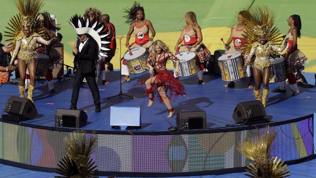 Colombian-pop-star-Shakira,-centre-in-red,-performs-during-the-closing-ceremony-before-the-World-Cup-final-soccer-match-between-Germany-and-Argentina-at-the-Maracana-Stadium-in-Rio-de-Janeiro,-Brazil,-Sunday,-July-13,-2014.-(Themba-Hadebe/AP)