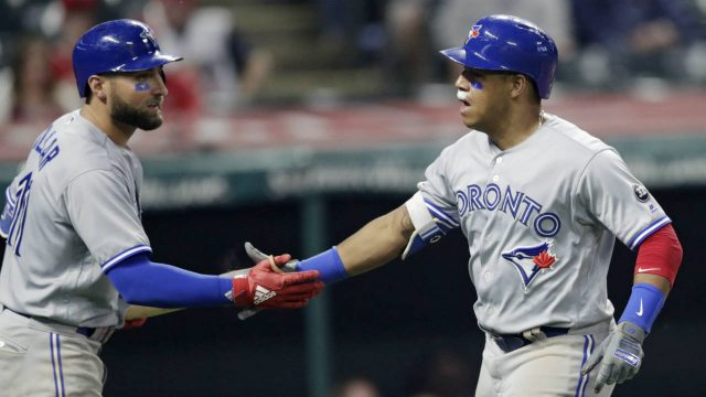 Toronto-Blue-Jays'-Yangervis-Solarte,-right,-is-congratulated-by-Kevin-Pillar-after-Solarte-hit-a-solo-home-run-during-the-second-inning-in-the-second-game-of-a-baseball-doubleheader-against-the-Cleveland-Indians,-Thursday,-May-3,-2018,-in-Cleveland.-(Tony-Dejak/AP)