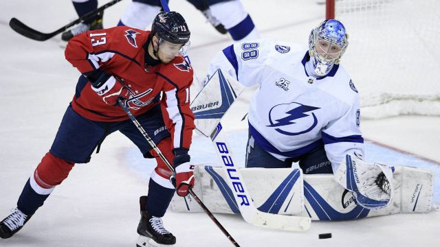 Tampa-Bay-Lightning-goaltender-Andrei-Vasilevskiy-(88),-of-Russia,-watches-the-puck-next-to-Washington-Capitals-left-wing-Jakub-Vrana-(13),-of-the-Czech-Republic,-during-the-third-period-of-Game-4-of-the-NHL-hockey-Eastern-Conference-finals-Thursday,-May-17,-2018,-in-Washington.-The-Lightning-won-4-2.-(Nick-Wass/AP)