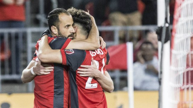 Toronto-FC-midfielder-Victor-Vazquez-(left)-celebrates-with-Jonathan-Osorio-after-scoring-his-team's-opening-goal-against-Philadelphia-Union-during-first-half-MLS-action-in-Toronto-on-Friday-May-4,-2018.-(Chris-Young/CP)
