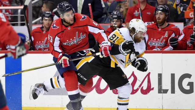 Washington-Capitals-right-wing-Tom-Wilson-(43)-collides-with-Pittsburgh-Penguins-right-wing-Phil-Kessel-(81)-during-the-first-period-in-Game-2-of-an-NHL-second-round-hockey-playoff-series,-Sunday,-April-29,-2018,-in-Washington.