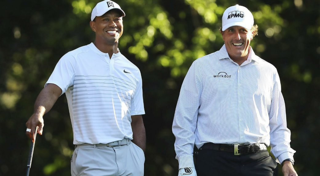 Tiger-Woods,-left,-and-Phil-Mickelson-share-a-laugh-on-the-11th-tee-box-while-playing-a-practice-round-for-the-Masters-golf-tournament-at-Augusta-National-Golf-Club-in-Augusta,-Ga.,-Tuesday,-April-3,-2018.-(Curtis-Compton/AP)