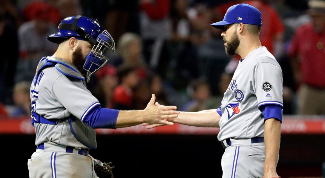 russell-martin-celebrates-blue-jays-win-with-ryan-tepera