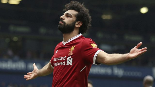 Liverpool's-Mohamed-Salah-celebrates-scoring-his-side's-second-goal-of-the-game,-during-the-English-Premier-League-soccer-match-between-West-Bromwich-Albion-and-Liverpool,-at-The-Hawthorns,-West-Bromwich,-England,-Saturday-April-21,-2018.-(Nigel-French/PA-via-AP)