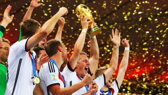 Germany's-Bastien-Schweinsteiger-lifts-World-Cup-trophy-teammates-in-Rio-de-Janeiro