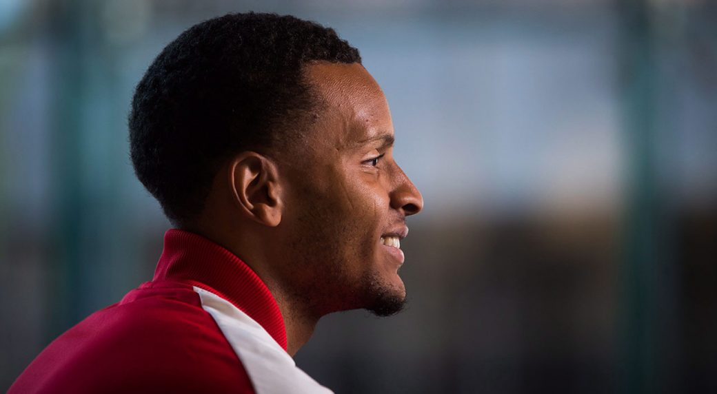 andre_degrasse_smiles_for_the_camera