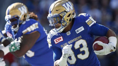 andrew-harris-runs-the-ball-follows-blocks-blue-bombers