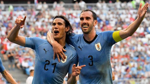 edinson-cavani-celebrates-with-uruguay-teammate-diego-godin