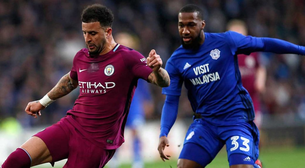 kyle-walker-vies-for-ball-with-junior-hoilett